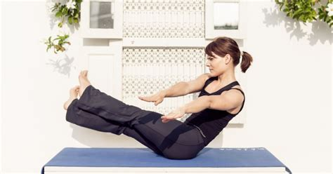 boat pose arm pulses yoga poses to detox cleanse and improve digestion