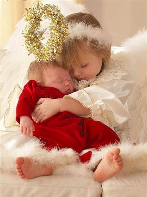 sweet  angel hugs baby sister photo ariel skelley  corbis images christmas baby