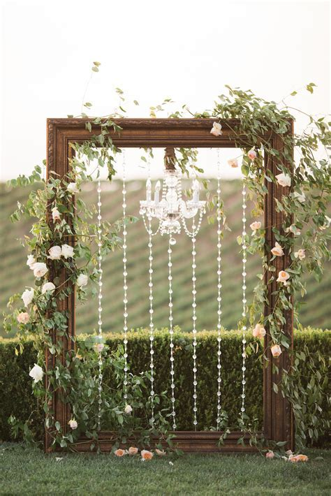 Frame & chandelier wedding arch   Winery West Lawn   Jenna
