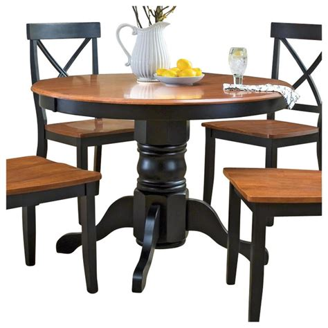 dining table houzz home styles pedestal casual dining table in black and cottage oak finish transitional