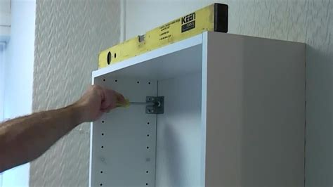 how to hang wall cabinets how to install a bathroom cabinet on a plasterboard wall