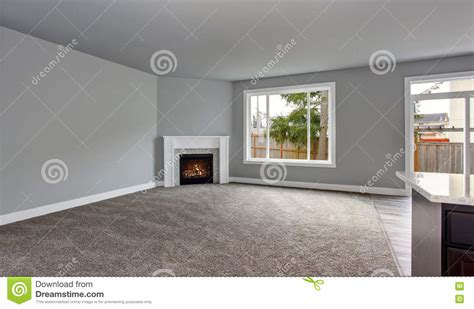 grey house interior grey house interior of living room with firwplace and carpet floor stock photo