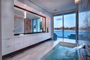 Seaside bathroom features full height sliding glass patio access with