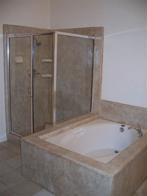 decorative concrete overlay over tile on shower and bathtub surround