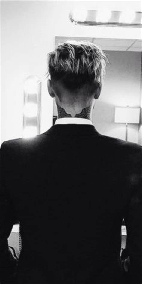 justin bieber wings tattoo justin s neck tattoos his world is my world and his