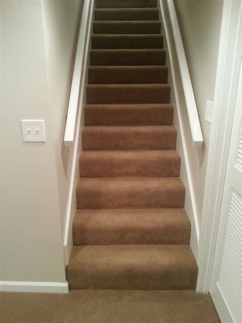 finish basement stairs basement finish carpeted stairs and handrails schrader s contracting