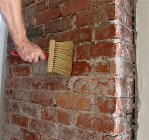 exposed brick bathroom wall small chimney toilets subway
