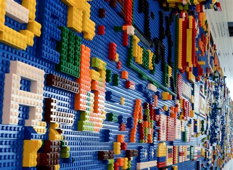 yotel s interactive lego wall invites guests to play play to stay at yotel inhabitat new