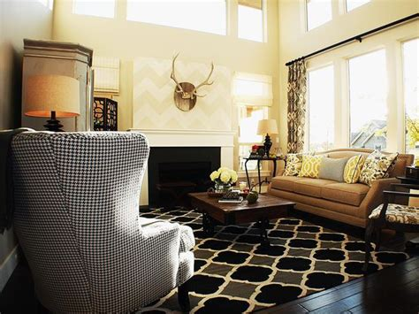 hgtv designer portfolio living rooms neutral living room with antlers mounted over fireplace