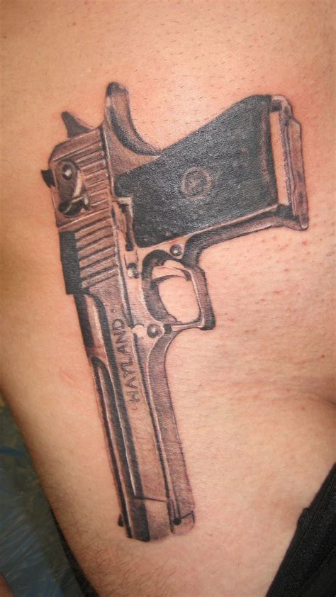 gun tattoos on thigh gun tattoos on hips live tattoos