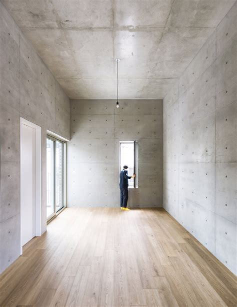 exposed concrete walls the inside of this building is finished minimally with