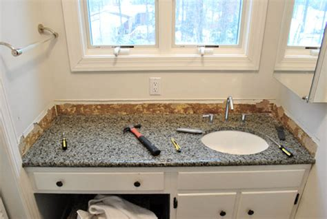 How To Put Up Backsplash In Bathroom by Removing The Side Splash Backsplash From Our Bathroom