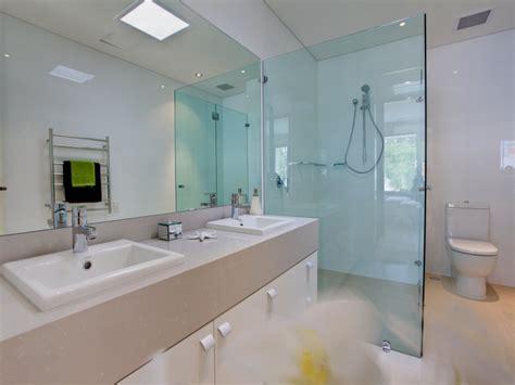 classic bathroom design with basins using glass