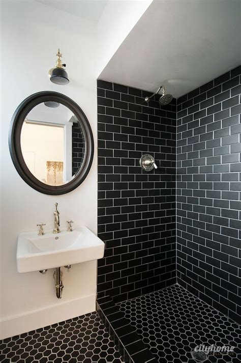 Modern bathroom black subway tile brass fixtures white wall mounted sink beautiful mid