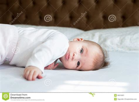 lay on the bed six month baby girl laying on the bed stock image image