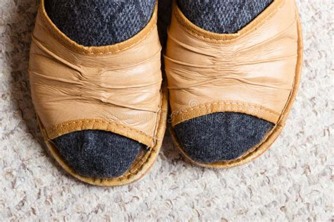 cozy comfort shoes woman feet with socks in slippers at home stock photo