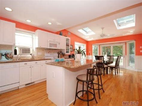 coral kitchen love the coral and white a house is made of walls and