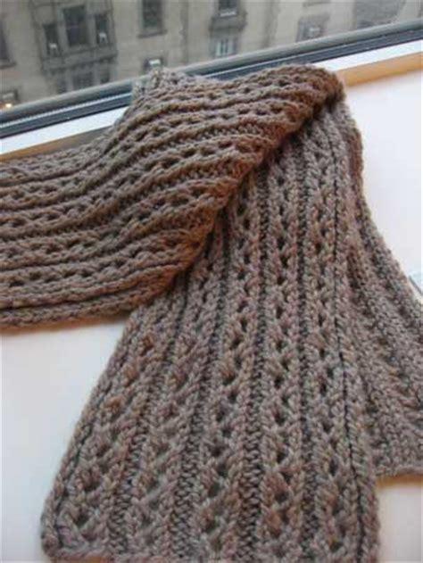 yo knitting chunky in a lace rib pattern that is beautifully