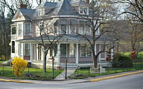 Colonial Style victorian style home with hairpin fence amp garden gate