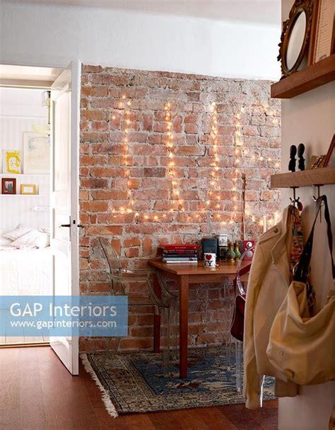 exposed brick wall lighting gap interiors modern hallway with fairy lights on