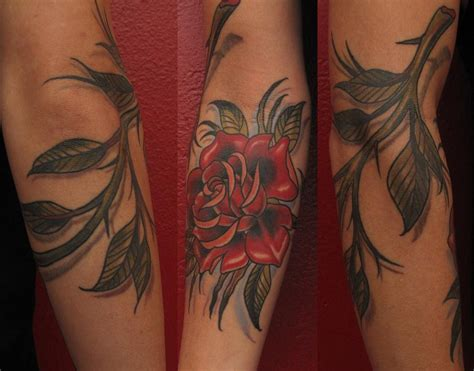 rose wrap around tattoo with thorns by robert hendrickson tattoonow