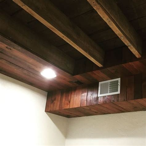 hide duct work and ceiling wires in basement with