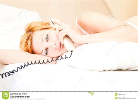 lay on the bed woman laying on bed talking on cordless telephone royalty