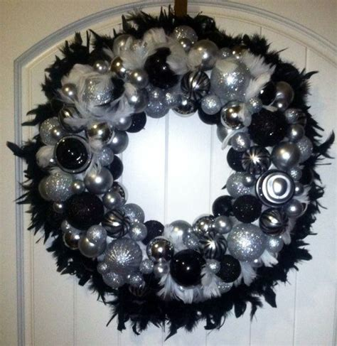 feather wreath with decorative ornaments black white