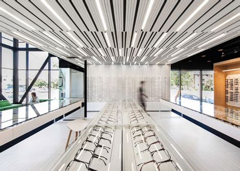 floor l with built in lava l la shed architecture separates eye clinic into light and