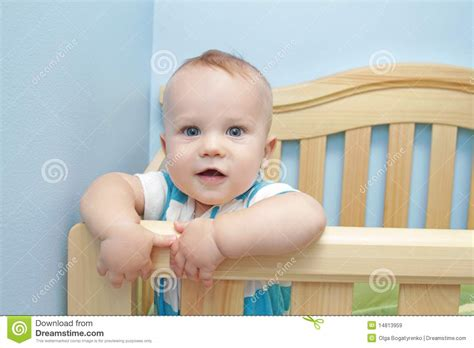 baby standing in crib baby standing in crib royalty free stock images image