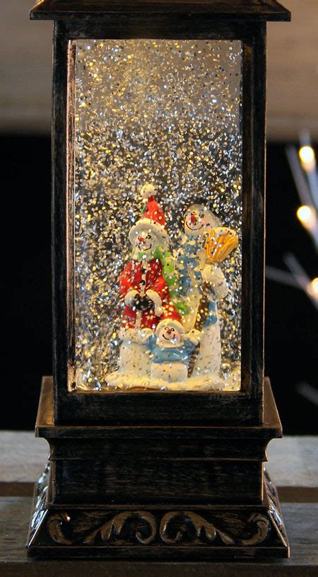 glittering christmas battery operated snow globes lighted moving glitter globe 11 inch battery operated snow family figurine buy now