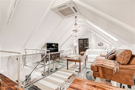 attic apartment  awesome glass flooring  stockholm