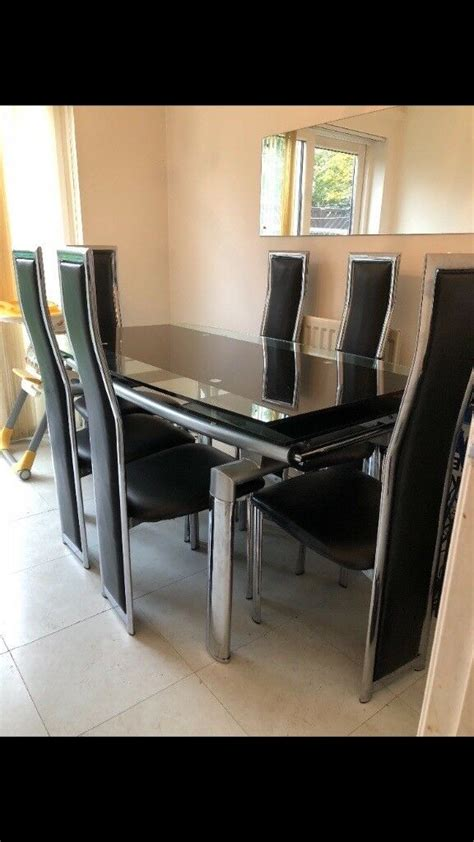 large extending dining room table  chairs  black