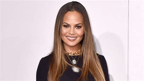 ama legend hair chrissy teigen is sorry not sorry for wardrobe