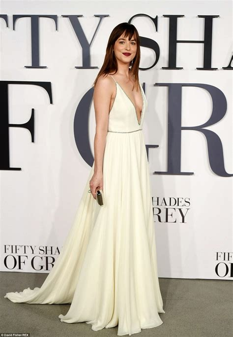 fifty shades of grey film premiere london dakota johnson flaunts cleavage in a low cut white dress