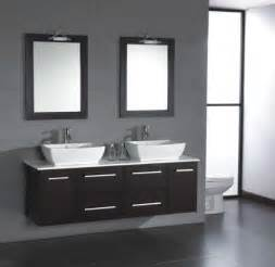 Bathrooms two matching glass or stone vessel sinks set atop a cabinet