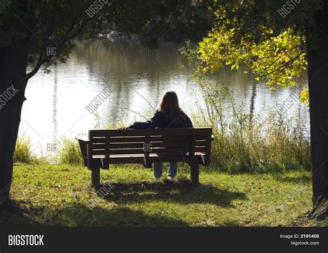 girl on bench lonely girl on park bench image photo bigstock