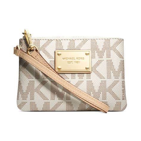 The Signature Chateau Wristlet Clutch by Lyst Michael Kors Jet Set Small Signature Wristlet In Brown