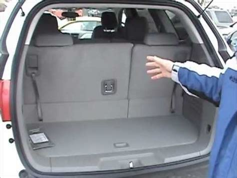 how to fold the rear seats down in a chevy traverse don