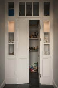 walk in pantry with bi fold doors flanked by built in