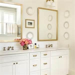 white cabinets with antique brass hardware navy bathroom vanity brass pulls design ideas