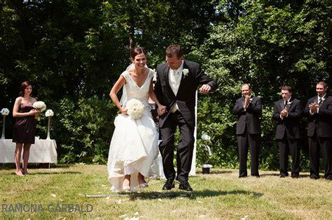 jumping the broom wedding tradition ceremony winnipeg wedding photographer broom