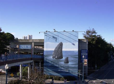 mural of whales at parking garage at pier 39