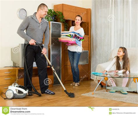 with parents cleaning at home stock photo image