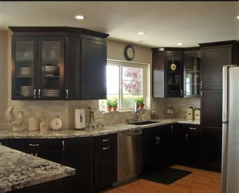 laying out kitchen cabinets tumbled marble subway tile backsplash dark cabinets