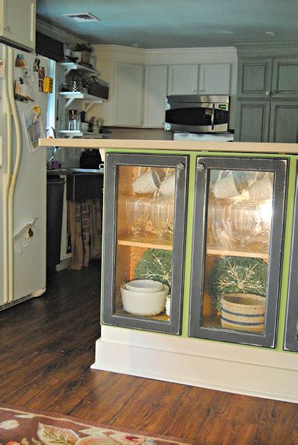 add glass to kitchen cabinet doors the painted home adding glass doors to my kitchen