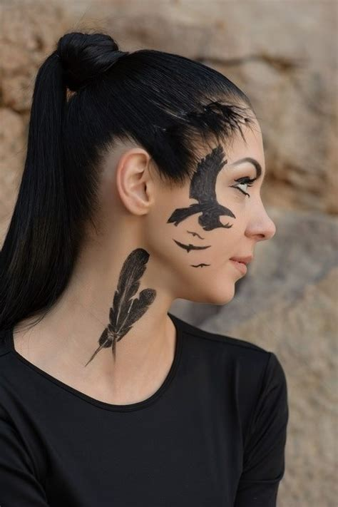 feather and flying bird face tattoo