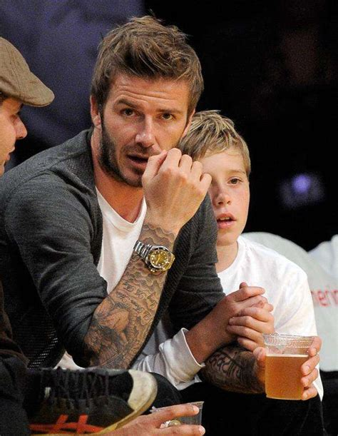 a guide to all of beckham s tattoos all of david beckham s 51 tattoos and their meanings