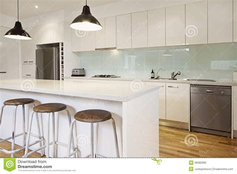 white kitchen island with stools white contemporary kitchen with island stock photo image