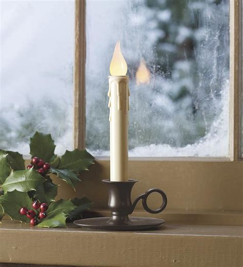 candle in window welcoming christmas decor pinterest